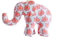 This darling plush elephant in pink and yellow will be a delightful addition to your child's room.  rikshawdesign.com