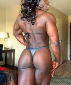Ebony Mistress Treasure shows her back side muscles