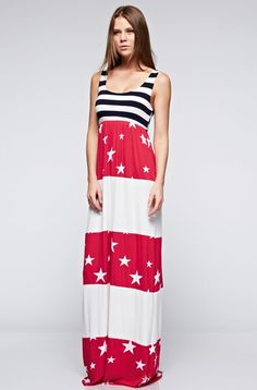 The perfectmaxi dressfor spring! Patriotic striped and printed maxi dress. Fits true to size, the model is shown wearing a small. Made ofrayon/spandex fabric.