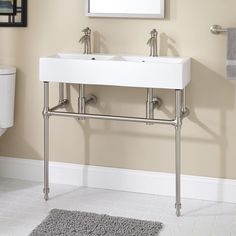 33.5x13... Not sure how you'd wash your face, though... Clagon+Double+Console+Sink+with+Brass+Stand