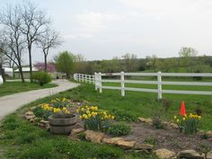 like this for the entrance to our farm....love the landscaping with rocks and seasonal plants