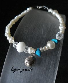 Hand made bracelet of fresh water pearls,turquoise and silver 925 shell Made by Eirini Svarnia. Price 35.00 euro
