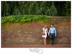Newport Mansions brick wall engagement photos, stylish summer white dress holding purse | Whiting Photography