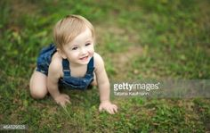 Stock Photo : Happy, smiling Baby crawling around in Grass