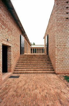 Clay brick education centre in Rwanda by Dominikus Stark Architekten Clay brick education center in Rwanda by Dominikus Stark Architekten Brick Architecture, Minimalist Architecture, Education Architecture, Contemporary Architecture, Architecture Details, Interior Architecture, Concrete Interiors, Brick Detail, Exposed Brick Walls