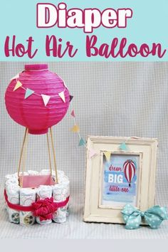 """Looking for a cute and unique baby shower gift? This is a tutorial on how to make a Diaper Hot Air Balloon plus a free printable for the cute """"dream big little one"""" picture to go with it. Makes the PERFECT baby shower gift!"""