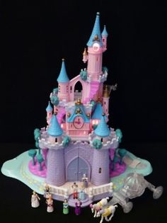 Polly Pocket Cinderella Castle, my second favorite toy next to my customer, hand built Barbie house.