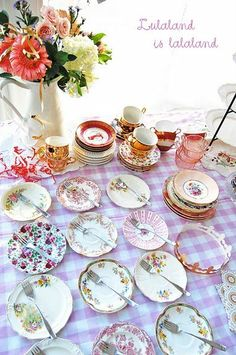 mismatched china. Definitely a vintage feel and those can easily and cheaply be found at flea markets.