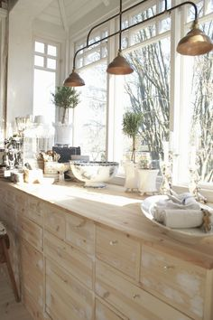 Light fixture and bleached wood cabinets - beautiful combination. Love the light!