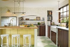 The yellow paint in this Hawaiian kitchen lets the sunshine in.