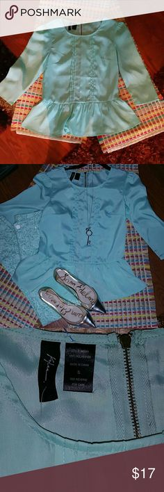 NWT KYLEE TEAL BLUE 3/4 SLEEVE TOP Brand new KYLEE top size Small zips in back and has a peplum style bottom 100% polyester which means it's easy to care for and keep the wrinkles out. Beautiful top, bundle BISOU BISOU Size 2 skinny jeans that match perfectly for a good discount. Make an offer today, good cause! KYLEE Tops Blouses