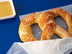 Almost-Famous Soft Pretzels Recipe-FoodNetwork.com. I've made these several times and I love them for how easy they are and so tasty.  I make a few changes to the original: brushing 2 T. melted butter at end and baking only 8 min. Fun for the kids to help with!