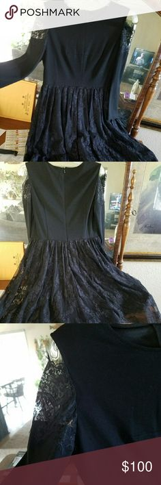 Elegant black dress high/long bottom. Lace bottom, fully lined, lace on top of each sleeve  This dress is new, never worn, purchased to wear in Vegas, but did not bring. Tags are not attached. But it is NEW. Dresses High Low