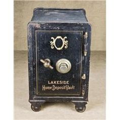 "Old iron floor safe approx. 11"" wide, 13-1/2"" deep and 14"" high on iron wheels in overall good condi"