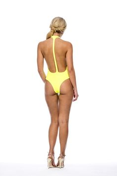The low cut racer back style of this daring one piece adds oomph to your summer style. The Latin Cut bottom fits your booty just right, and allows you to be sexy, while also still leaving something to the imagination. Talk about Class meeting Style! The Neon Yellow Peixoto Flamingo is also available in Red, Black, and Neon Pink #designerswimsuit