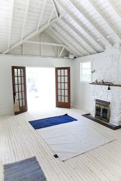 Love the exposed rafters and the wood ceiling.  French Doors in white space, via Mjolk/Kitka | Remodelista