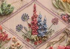 found it! Embroidery with ribbons from the Ribbon embroidery and stumpwork book! i want to learn this!!!