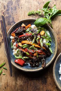 30 Minute Korean Beef and Peppers with Sesame Rice. overhead photo of 30 Minute Korean Beef and Peppers with Sesame Rice and chopsticks on side of bowl Asian Recipes, Beef Recipes, Cooking Recipes, Healthy Recipes, Ethnic Recipes, Delicious Recipes, Healthy Food, Tasty, Half Baked Harvest