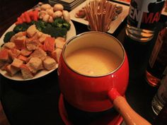 I think a fondue pot for a 60's cocktail party is a great idea!