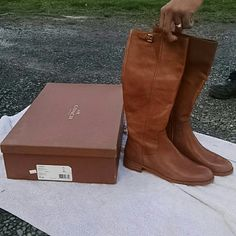 Brand new coach boots Beautiful authentic coach boots. Was a gift, tried on and didn't fit. True to size. Comes with box. Has small little handling marks as shown in pic two, but no scratches etc Coach Shoes Winter & Rain Boots