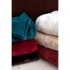 This attractive king blanket set comes in colors of cream, camel, pomegranate, chocolate, ruby and teal to provide warmth for all seasons. Made of 100-percent solid polyester microfiber, this blanket is yours to enjoy for many years in the future.