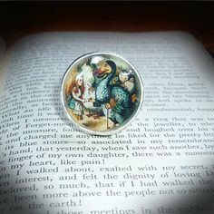 Alice and the Dodo adjustable ring -Large silver plated, adjustable resin ring depicting Alice in Wonderland meeting the Dodo.  The front is one inch in diameter. Item comes gift wrapped. - £8.99