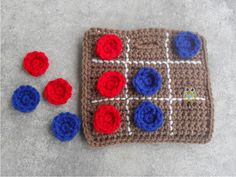 """Travel Tic Tac Toe Game would make a great stocking stuffer for kids that travel a lot. Easy game to play in the car on long rides. Pieces are stored inside bag and game played on outside of bag. Comes with the board game bag and 5 circles in two colors.  -Made with 100% acrylic yarn. - 5 1/2""""..."""