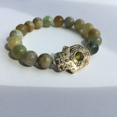 Individual bracelet to enhance the influence of the Sun and Uranus. Bronze guarding hand - hamsa - with chrysolite and beryl. Price on request