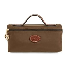 The leather handle and water-resistant nylon make this perfect for traveling. Check out the top 10 best cosmetic bags on Rank & Style Best Makeup Products, Beauty Products, Large Toiletry Bag, Diy Makeup Bag, Makeup Essentials, Leather Handle, Longchamp, Makeup Yourself, Cosmetic Bag