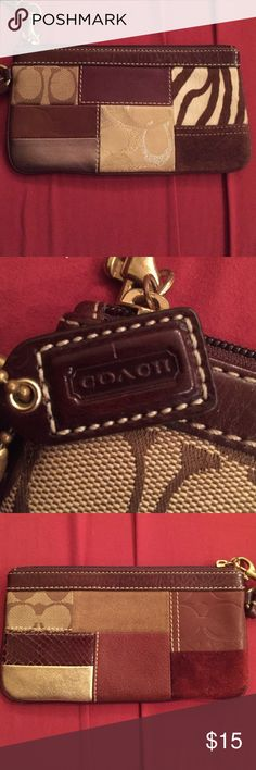Coach wristlet Medium size perfect condition. Neutral colors perfect for a dinner date. MUST have! Purchased from Macy's. Coach Bags Clutches & Wristlets