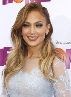 Jennifer Lopez's smoky mauve shadows and matching lip gloss complement her olive skin beautifully. Her half-pinned hairstyle also adds a glamorous feel to this beauty look. #Celeb #Beauty