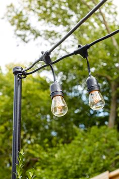 We're here to help you set up string lights on your porch for your next outdoor get-together. Even if you don't have already deck or porch posts. #homedecorideas #patio #patiolights #diyprojects #homeimprovement #bhg