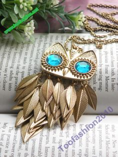 Pretty retro gold blue eyes owl with feathers by toofashion2010, $5.99
