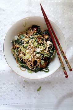 Soba Noodles with Wasabi and Shiitake Mushrooms | In Japan, China, and many other Asian countries, tradition calls for eating long noodles, which signify longevity, on New Year's Day. In this simple noodle dish, crisp wasabi stalks add texture, while the tender, chewy leaves are a complex substitute for bitter greens.