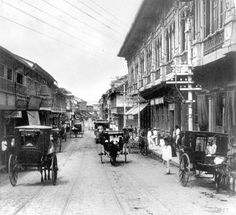 #Philippine_History  ____  Escolta, the principal business street in Manila, Philippines, circa 1899