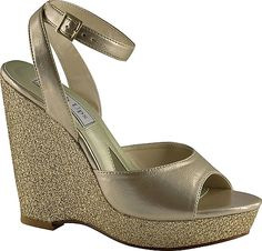 """Touch Ups Women's Shoes in Champagne Color. Plenty of glitter paired with metallic material make this the perfect shoe for any special event. Synthetic upper with ankle strap and adjustable buckle for stability and comfort. Lightly cushioned footbed. PVC outsole. 4"""" wedge heel #TouchUps #champagne #shoes #fashion #style"""