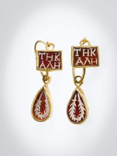 """The earring is inset with sardonyx intaglios. It has one square stone inscribed (in Greek) TE KALE (""""To the beautiful one"""") and one teardrop-shaped pendant inscribed with a wreath. This earring forms a pair with 66.318b."""