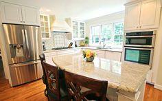 Beautiful, traditional kitchen with granite island, white cabinets and custom tile back splash. www.jamesriverconstruction.com
