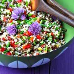 hearty vegan salad with beluga lentils, quinoa, israeli couscous and chives, including flowers