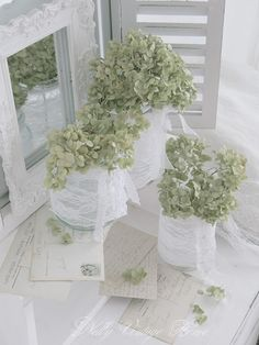 Hydrangeas in lace-wrapped jars (from Nelly Vintage Home)