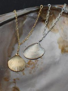 Like this idea.  drill hole in shell use jump ring and string on chain. Seashell Necklace