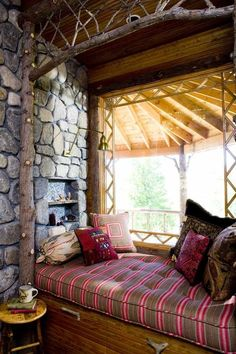This cozy, rustic book nook is brightened by a large picture window.