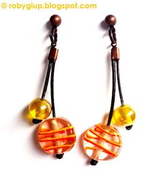 RobyGiup Handmade: Orecchini in cuoio e perle di vetro gialle - Earrings in leather and yellow glass beads