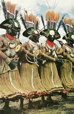 New Guinean warriors pounding drums National Geographic | July 1969
