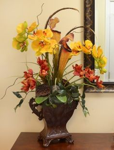 floral home decor yellow and red orchids in pitcher planter floral home decor creates custom silk orchids artificial orchids and silk floral designs to - Silk Orchids