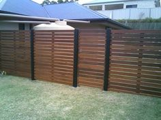 Fence Designs by Unique Timber Fencing - vertical and with thinner wood posts