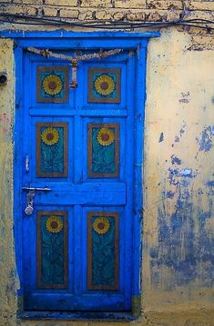 Bright Matte Blue Door – Amazing Pictures - Amazing Travel Pictures with Maps for All Around the World