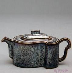 Tea Pot: This work by Professor Xu Wenhui use made of colored glaze decoration techniques.