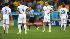 England players react to Luis Suarez's second goal in the 2-1 defeat to Uruguay