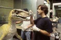 Character Creator John Rosengrant paints layers of color to an animatronic velociraptor puppet featured in THE LOST WORLD: JURASSIC PARK.